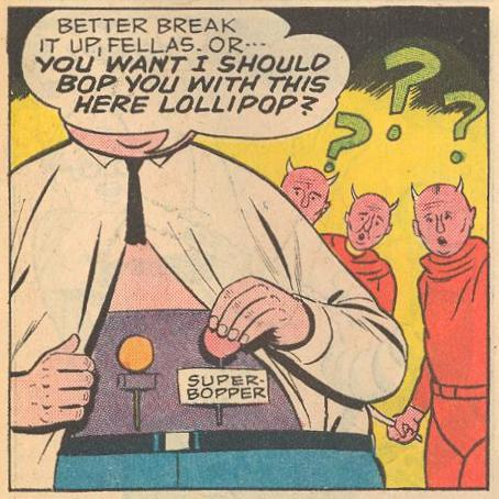 Herbie threatens to bop with that there lollipop, a super-bopper from his lollipop belt.